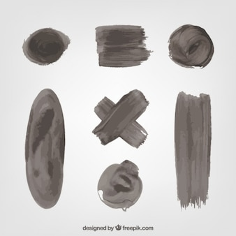 Set of black paint stains and brush strokes