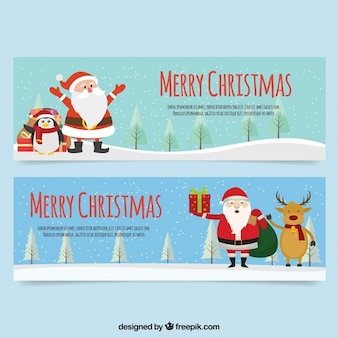 Set of flat banners of santa claus with a penguin and a reindeer
