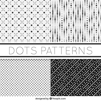 Set of four black and white patterns with dots