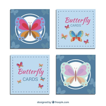 Set of four cards with blue background and butterflies