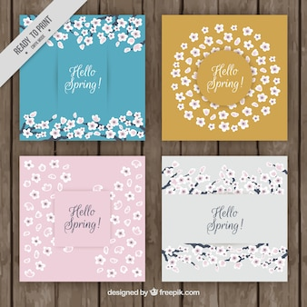 Set of four spring greeting cards with hand-drawn flowers