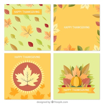 Set of four thanksgiving cards with dry leaves