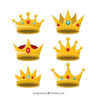 Set of golden crowns with precious stones