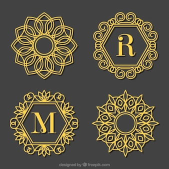 Set of golden ornamental capital letter logos