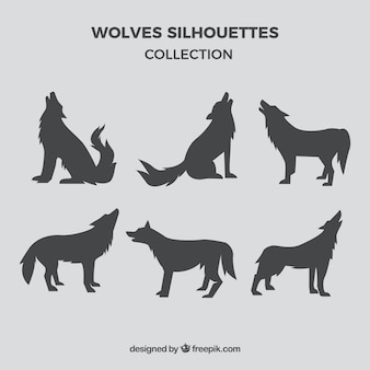 Set of gray wolf silhouettes