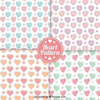 Set of hand drawn decorative hearts patterns