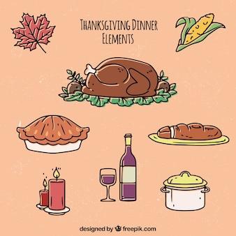 感謝の夕食の要素を描いた手のセット