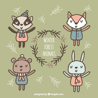 Set of happy animals with hand-drawn winter clothes