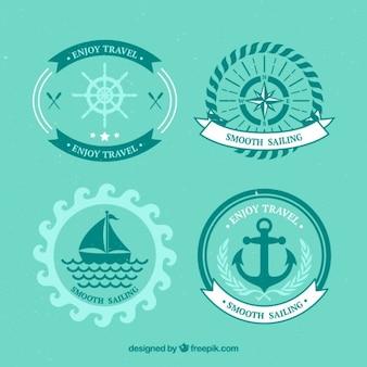 Set of sailing badges in flat design
