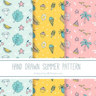 Set of summer patterns hand drawn in pastel shades