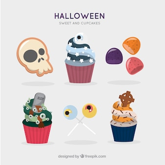 Set of tasty cupcakes and candies