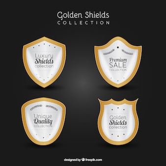 Set of white and golden shields