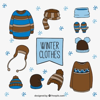Set of winter clothes with hand drawn elements