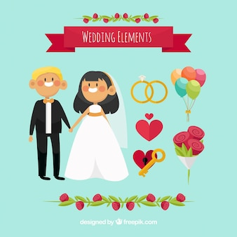 Set with happy newlyweds and decorative items