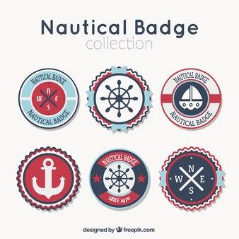 Several decorative nautical badges