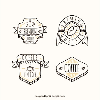 Several hand-drawn coffee badges
