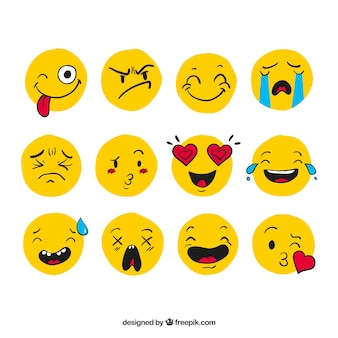 Several hand-drawn emoticons with different facial expressions