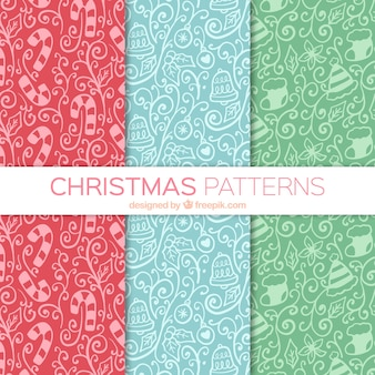 Several hand drawn ornamental patterns with christmas elements