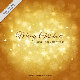 Shiny golden background of merry christmas and new year