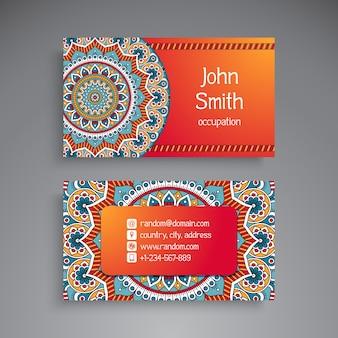 Shiny orange business card with mandala concept