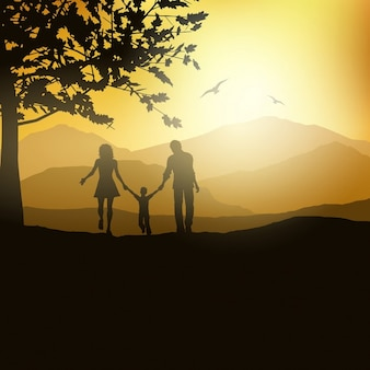 Silhouette of a family walking in the countryside