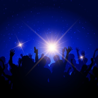 Silhouette of a party crowd on a night sky background