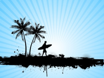 Silhouette of a surfer on a palm tree background