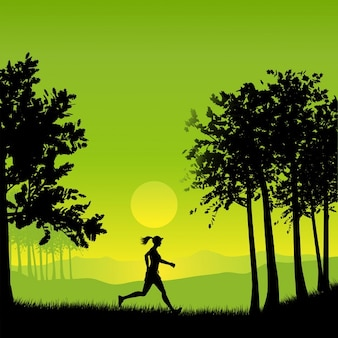 Silhouette of a woman jogging in the countryside