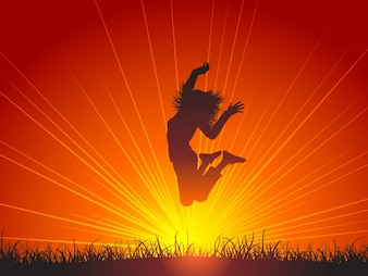 Silhouette of female jumping for joy