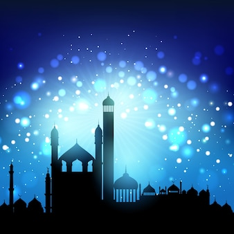 Silhouette of mosques against a bokeh night sky