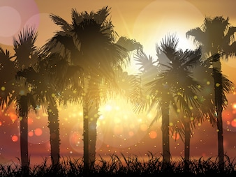 Silhouette of palm trees against a sunset sky