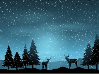 Silhouette with reindeers on a landscape background