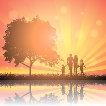 Silhouettes of a family walking in the countryside