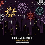 Silhouettes of buildings with fireworks background