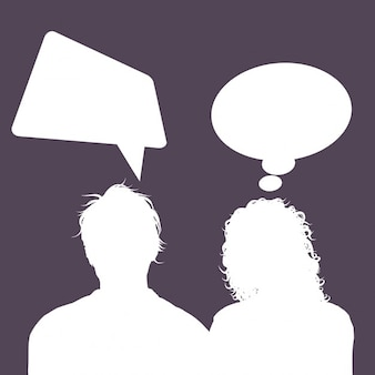Silhouettes of male and female avatars with speech bubbles