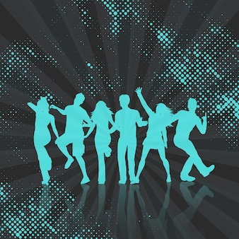 Silhouettes of people dancing on a halftone dots background