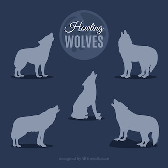 Silhouettes of wolves howling