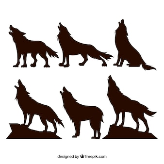Silhouettes set of wolves howling