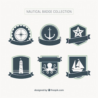 Six nautical badges with ribbons