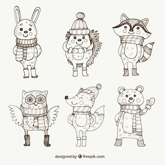Sketches set of lovely animals with winter elements