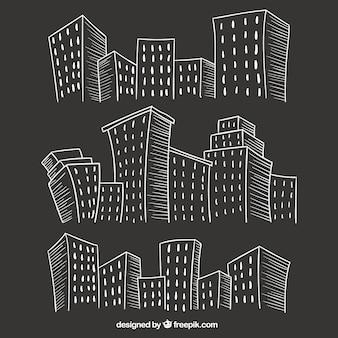 Sketchy city buildings on blackboard