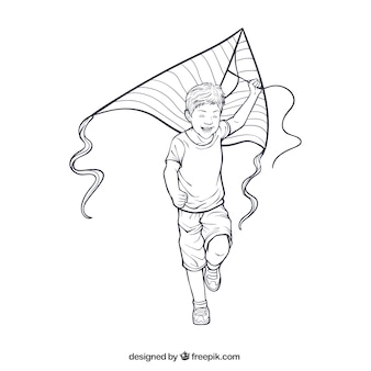 Smiling boy playing with his kite