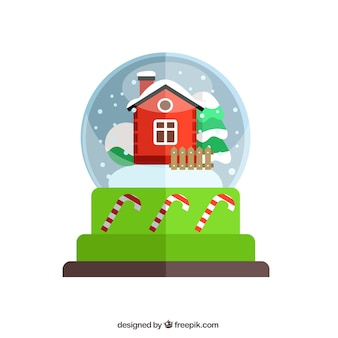 Snow globe with a red house inside