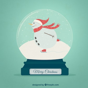 Snowman doins ice skating inside a crystal ball