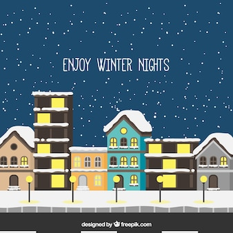Snowy city background in flat design