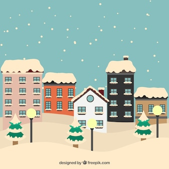 Snowy city background with cute houses