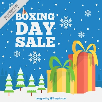 Snowy landscape background with boxing day gifts