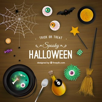 Spooky halloween background on wooden surface