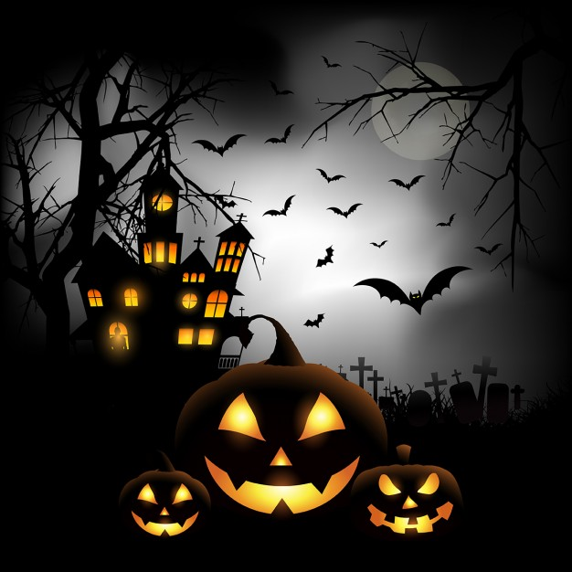 Spooky halloween background with pumpkins in a cemetery