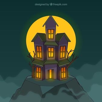 Spooky house with full moon